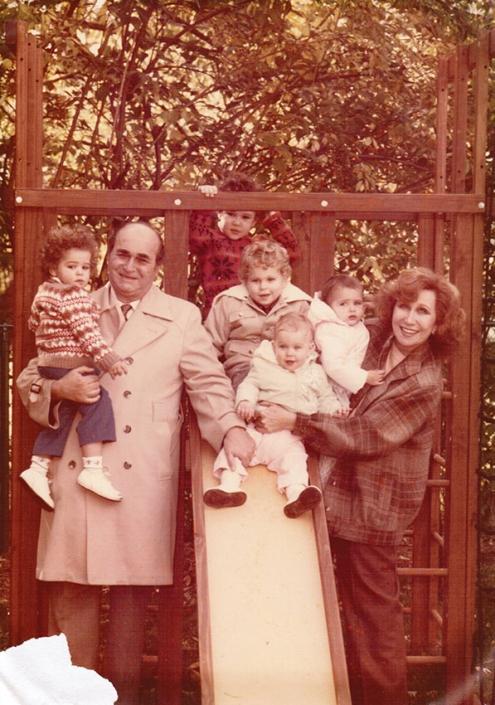 Nanny, Papa, and the grandkids (Nanny holding me, Papa holding Evan, Isaac, Sammy, and Melinda on slide), 1983