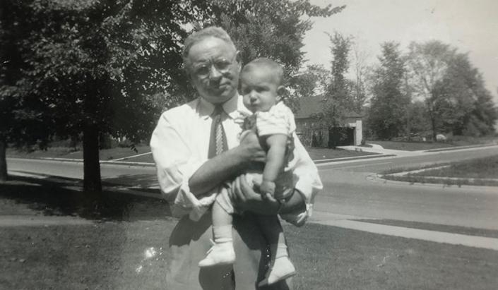 My great-grandfather Ephraim Schottenstein holding my dad in Columbus, 1950