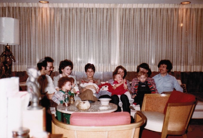 Mom holding infant me with my first cousins, aunts and uncles at Nanny's house, 1982: (from left) Bobby, Caroline, Isaac, Evan, Mom, me, Debbie, Suzanne, Gail, Sammy, and Gary
